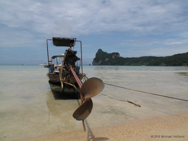A long-tailed boat on the beach of Phi Phi Island